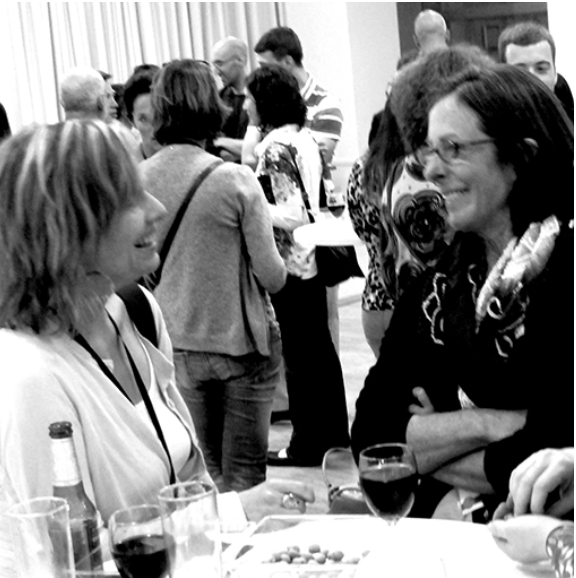 people talking at a past EPIC conference reception
